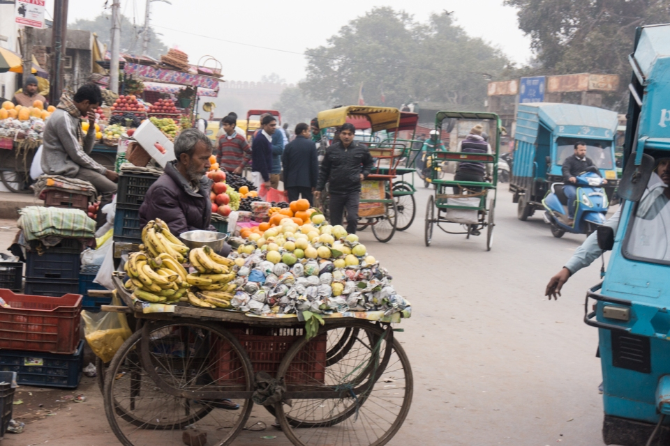 Vehicles contend with stalls and carts on the streets of most towns